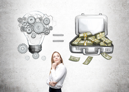 making money: Businesswoman with hand at chin looking up, bulb and open case with money equation drawn on concrete wall behind. Concept of making money. Stock Photo