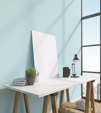 lamp window: Blank frame on white table, books on and under table, lamp, window to the right, city view. 3D rendering