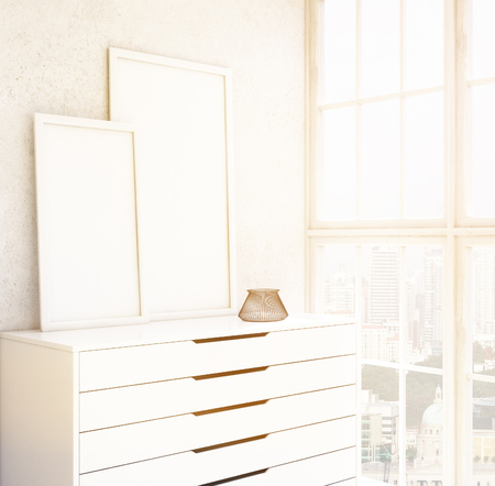 chest wall: Two blank frames on white chest of drawers, white wall, window to the right. 3D rendering