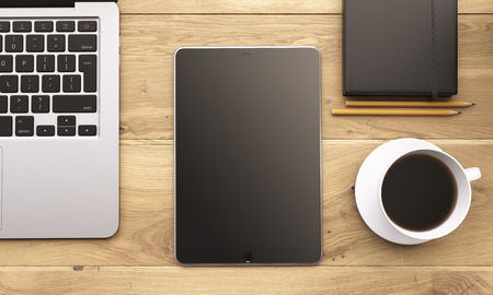 laptop screen: Laptop and tablet with black screen, coffee, plant and datebook on wooden table. Concept of workplace. Mock up. 3D rendering