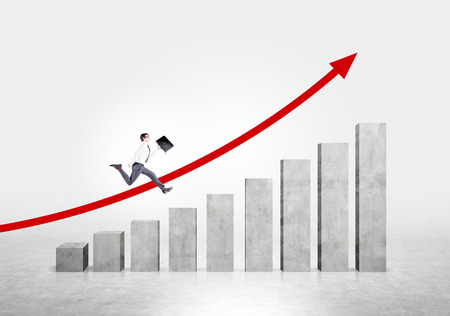 concrete stairs: Businessman running up stairs made of concrete blocks. Red arrow up at concrete background. Concept of career growth.