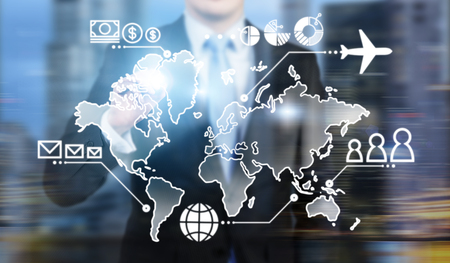 headquaters: Businessman standing in front of virtual map, money, people and communication points and plane on it. Concept of business logistics. Stock Photo