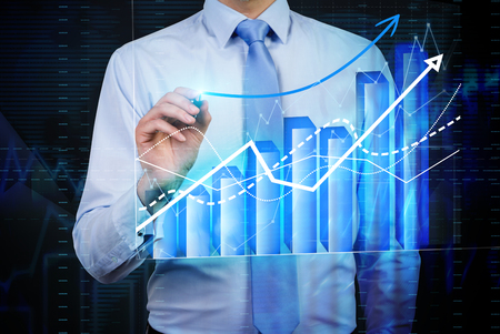 foreign bodies: Caucasian businessman drawing forex bar graph Stock Photo
