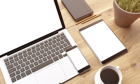 datebook: Laptop, smartphone and tablet with blank screens, coffee, plant and datebook on wooden table. Concept of workplace. Mock up. 3D rendering