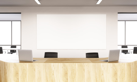 noone: Empty reception with laptops, big white board on wall behind. Front view. Concept of reception. Mock up. 3D rendering Stock Photo