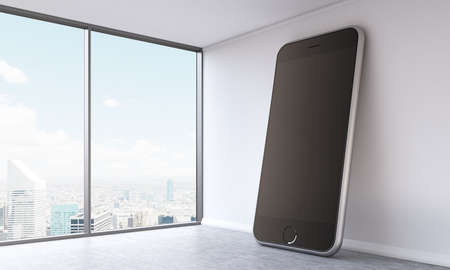 huge: Huge smartphone model with black screen in empty office. Panoramic window, city view. Concept of presentation. Mock up. 3D rendering