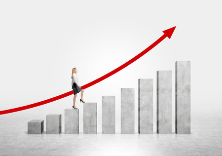 concrete stairs: Businesswoman going up stairs shaped by concrete blocks, red arrow uwards. Concrete background. Concept of career growth.