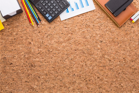 cork: Cork table, notebooks, graphs, calculator and pencils on it. Top view. Concept of work. 3D rendering Stock Photo