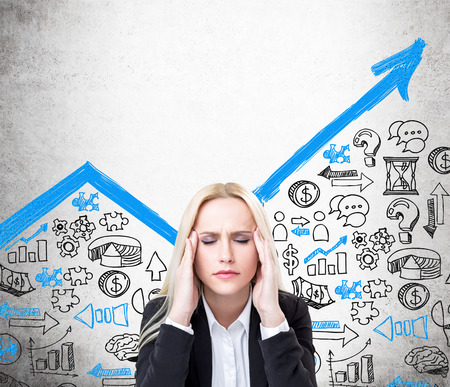 blue arrow: Research concept with stressed businesswoman and blue arrow sketch on cocnrete wall Stock Photo