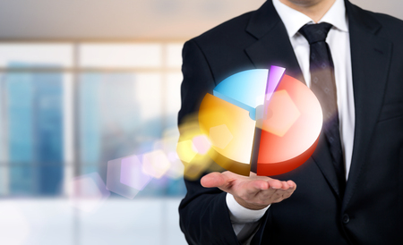 hand press: Businessman with colorful pie-chart on palm Stock Photo