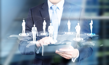 using tablet: Businessman using tablet with people silhouettes on networking system