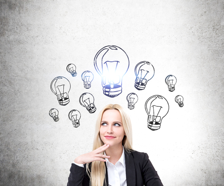 the thoughtful: Idea concept with happy thoughtful businesswoman and lightbulb skect on concrete wall Stock Photo