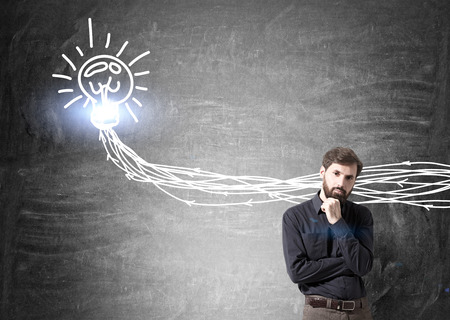 bearded wires: Idea concept with businessman and lightbulb wires sketch on concrete wall Stock Photo