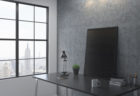 black picture frame: Sideview of workplace with black picture frame in interior with New York city view. Mock up, 3D Rendering