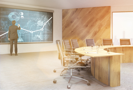 swivel: Businessman drawing business charts on blackboard in conference room interior. Toned image. 3D Rendering
