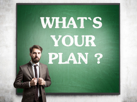 cement solution: Planning concept with businessman and blackboard on concrete wall Stock Photo