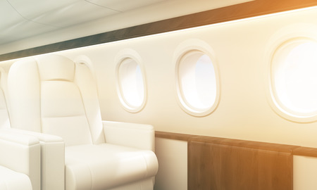 Aircraft interior with white leather armchair, wooden insertions and several portholes. Toned image. Sideview, 3D Rendering Stock Photo
