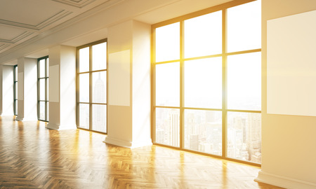 toned: Sunlit interior with wooden floor, blank posters on columns and New York city view. Toned image. Mock up, 3D Rendering Stock Photo