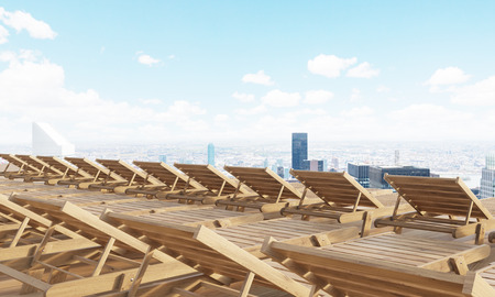 rearview: Rearview of numerous wooden chaise longues with New York city view. 3D Rendering