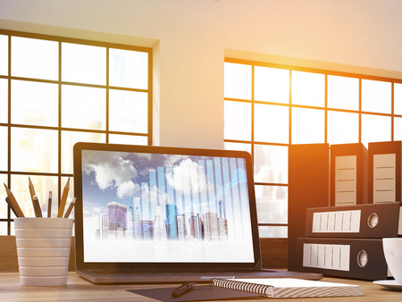 laptop screen: Closeup up of office workplace with business chart and buildings on laptop screen. 3D Rendering