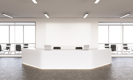 Empty white reception with laptops, big white board on wall behind, windows and meeting rooms at background. Concept of reception. Mock up. 3D rendering