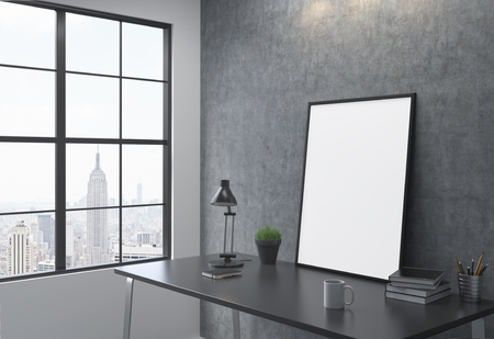 sideview: Sideview of workplace with blank picture frame in interior with New York city view. Mock up, 3D Rendering Stock Photo
