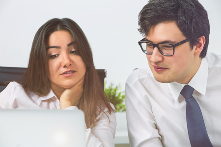 teamworking: Two businesspeople teamworking in office