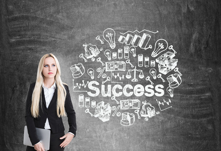 businesswoman standing: Success concept with thinking caucasian businesswoman standing against chalkboard with sketch Stock Photo