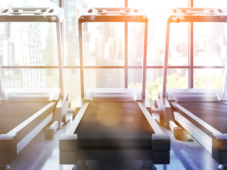 central park: Three treadmills in room with NY Central Park view and sunlight. Toned image, 3D Rendering