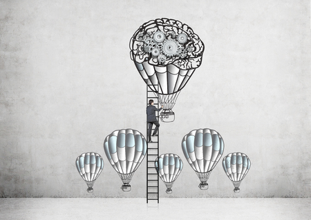 climbing ladder: Businessman climbing ladder on concrete wall with airballoons and gears sketch