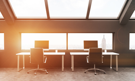 toned: Frontview of workplaces in black coworking area with New York city view. Toned image. 3D Rendering Stock Photo