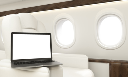 leather armchair: Blank white laptop placed on leather armchair handle in airplane interior. Mock up, 3D Rendering Stock Photo