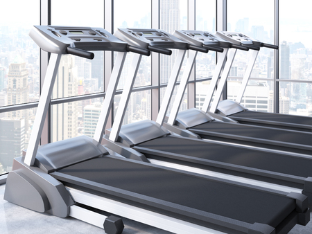 sideview: Sideview of treadmills in room with windows and New York city view. 3D Rendering Stock Photo