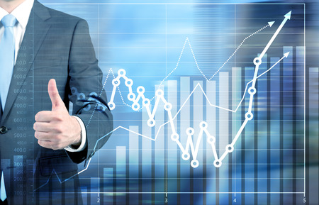 increase business: Success concept with businessman showing thumbs up next to business chart