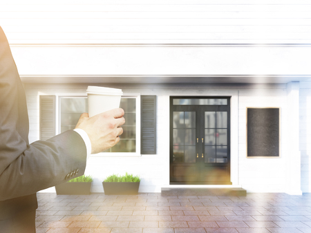 toned: Businessman hand holding coffee cup on cafe exterior background. Toned image, 3D Rendering Stock Photo