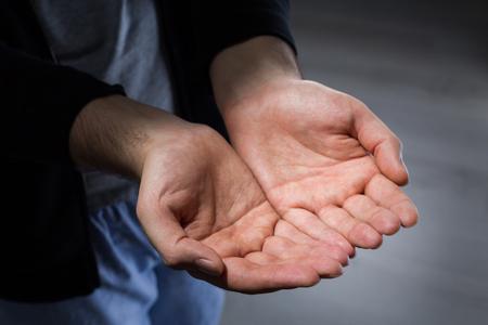 begging: Begging man with hands put together