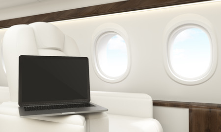 leather armchair: Blank laptop placed on leather armchair handle in airplane interior. Mock up, 3D Rendering