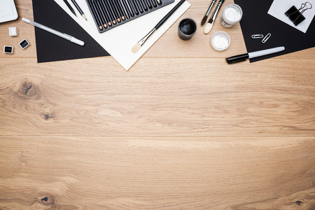 stationery items: Top view of wooden desktop with drawing tools and stationery items. Mock up