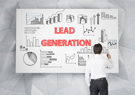Lead generation concept with businessman drawing business sketches on whiteboard Stock Photo