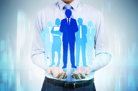 team leadership: Human resources concept with man holding businesspeople silhouettes Stock Photo