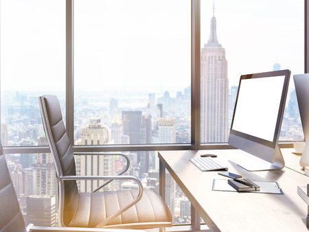 blank computer screen: Closeup of office workplace with blank computer screen and New York city view. Mock up, 3D Rendering