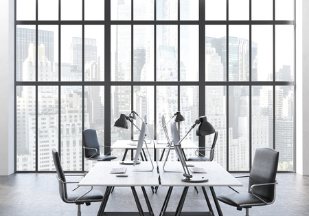 office window view: Coworking office interior with computer monitors on desks, chairs and window with New York city view. 3D Rendering
