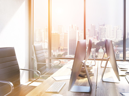 toned: Closeup of workplace in coworking office with New York city view. Toned image. 3D Rendering