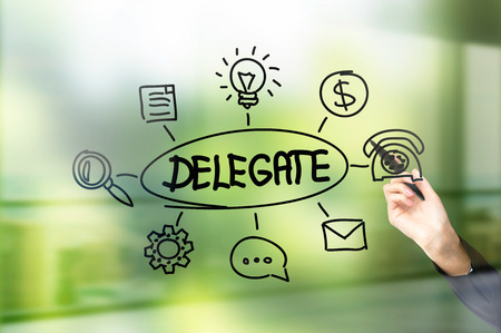 delegate: Businesswoman hand drawing delegate sketch on green background Stock Photo
