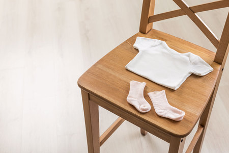 baby stuff: Wooden chair with baby stuff