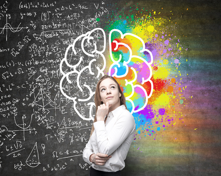 analytical: Right and left hemispheres, creative and analytical thinking concept with thoughtful businesswoman on background divided into colorful and mathematical formula walls Stock Photo