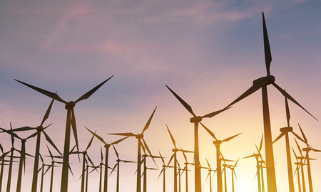 mills: Numerous backlit wind mills in the sky at sunset. 3D Rendering Stock Photo