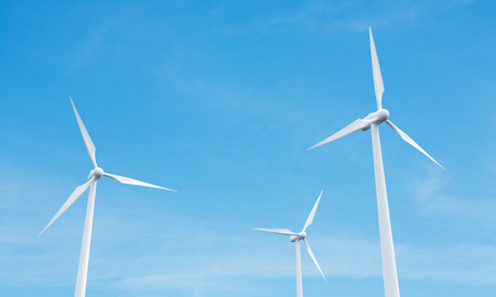 wind mills: Wind mills on blue clear sky background. 3D Rendering