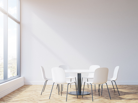 view window: Round table and chairs in conference room interior with wooden floor, blank wall and window with city view. Mock up, 3D Rendering Stock Photo