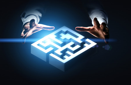 represented: Business challenge concept represented by hands grabbing abstract illuminated maze
